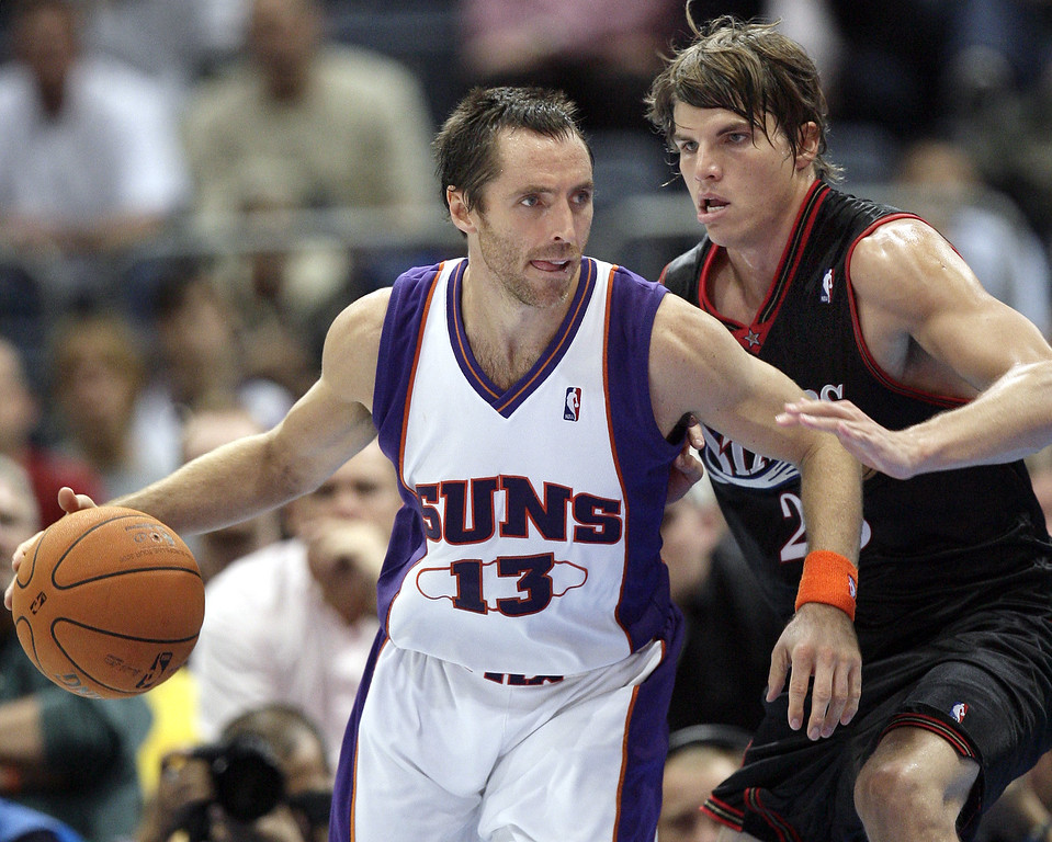 . Philadelphia 76ers Kyle Korver, right, fights for the ball against Steve Nash, left, of Phoenix Suns during a NBA Live Tour friendly basketball match between Philadelphia 76ers and Phoenix Suns at the Koeln Arena in Cologne, Germany, Tuesday, Oct. 10, 2006. (AP Photo/Michael Sohn)
