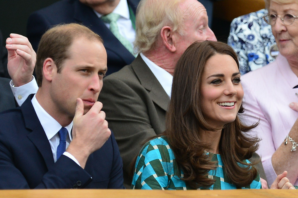 . Britain\'s Prince William, the Duke of Cambridge, and his wife Catherine, the Duchess of Cambridge, sit in the Royal Box on Centre Court before the start of the men\'s singles final match between Serbia\'s Novak Djokovic and Switzerland\'s Roger Federer on day thirteen of the 2014 Wimbledon Championships at The All England Tennis Club in Wimbledon, southwest London, on July 6, 2014.  CARL COURT/AFP/Getty Images