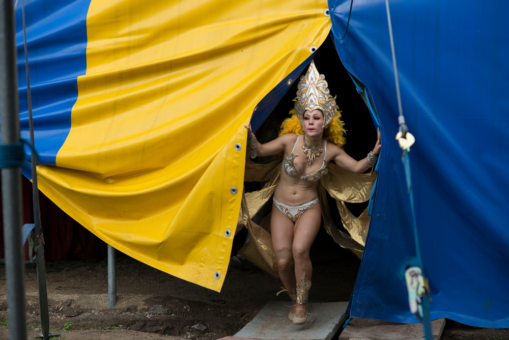 Description of . In this June 22, 2014 photo Karla Rosales, one of the performers with the Fuentes Gasca Brothers Circus, heads back to the the dressing room between performances in Mexico City. Recent legislation in the city will ban animals from the circus once the law takes effect next year. (AP Photo/Sean Havey)