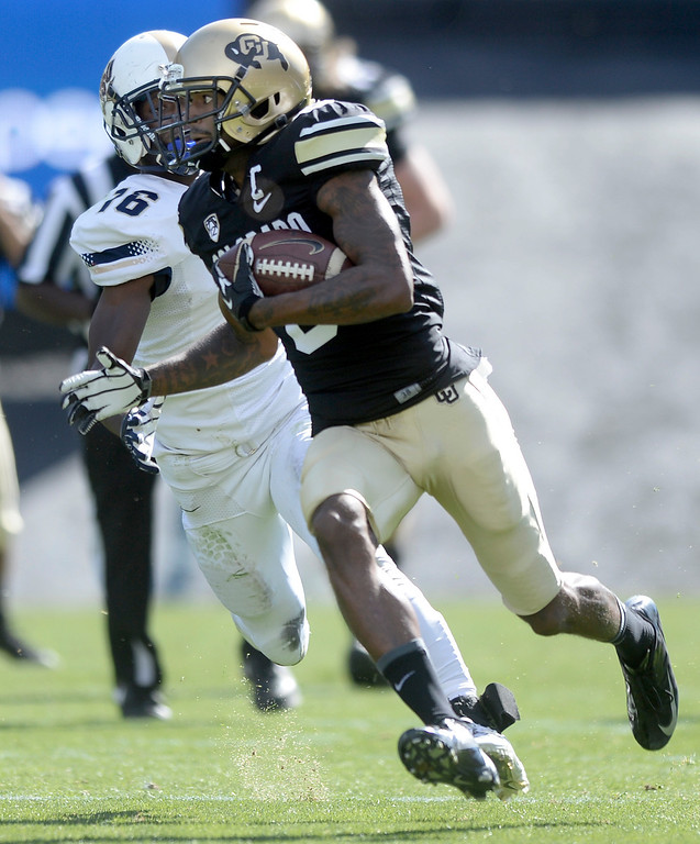 . University of Colorado\'s Paul Richardson sprints past Matrice Tucker for a touchdown after making a catch during a game against Charleston Southern on Saturday, Oct. 19, at Folsom Field in Boulder.  (Jeremy Papasso/Boulder Daily Camera)
