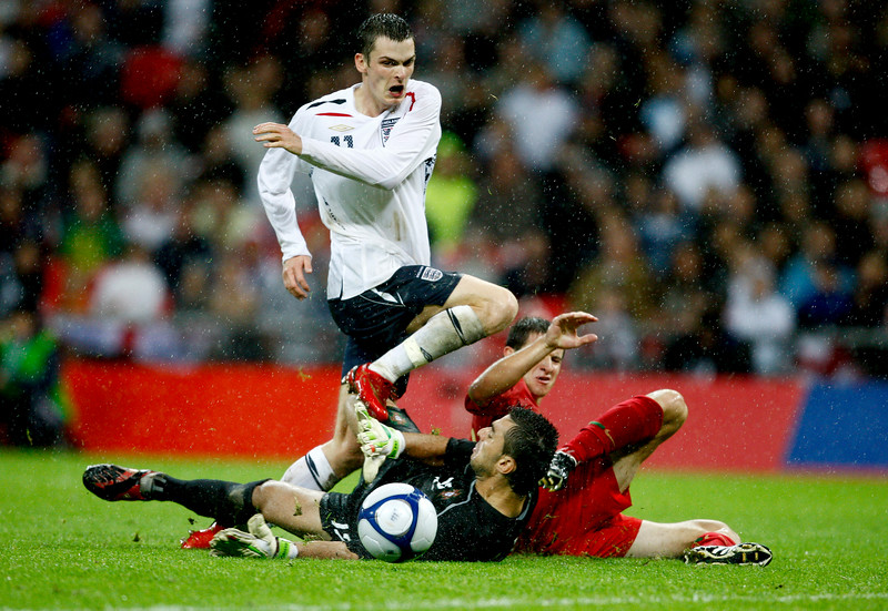 Adam Johnson of England & Rui Patricio & Bruno Pereirinha of Portugal