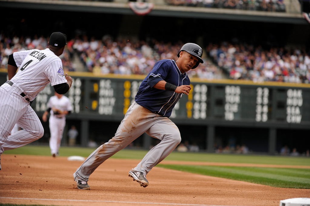 . A single by Jesus Guzman (15) of the San Diego Padres drives in Everth Cabrera (2) of the San Diego Padres in the first inning. (Photo by Karl Gehring/The Denver Post)