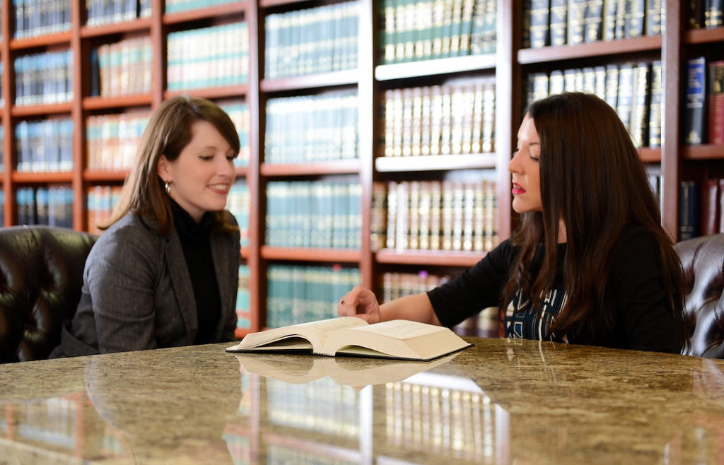 Attorney Victoria Dye works with a client.