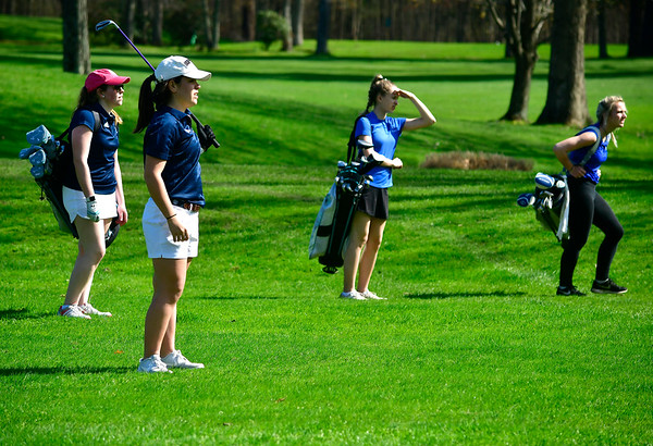 4/23/2019 Mike Orazzi | Staff Lauralton Hall's Erin Eason at the Westwoods Golf Course on Tuesday. Left to right: Lauralton Hall's Claire McCrory and St. Paul's Jillian Kiazim and Sarah Richardson