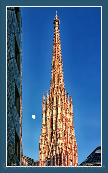 The Tower of St. Stephen's Cathedral With the setting sun and the rising moon The top has been restored recently.  It was built in the early 1400s, finished 1433, 134m high with eleven bells.