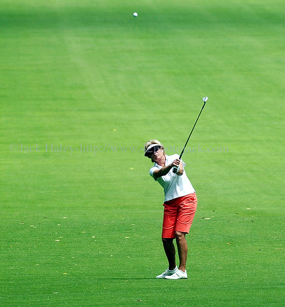 jhgolf2  - Jane Blalock hits from the fairway towards the fourth green during the TOC.