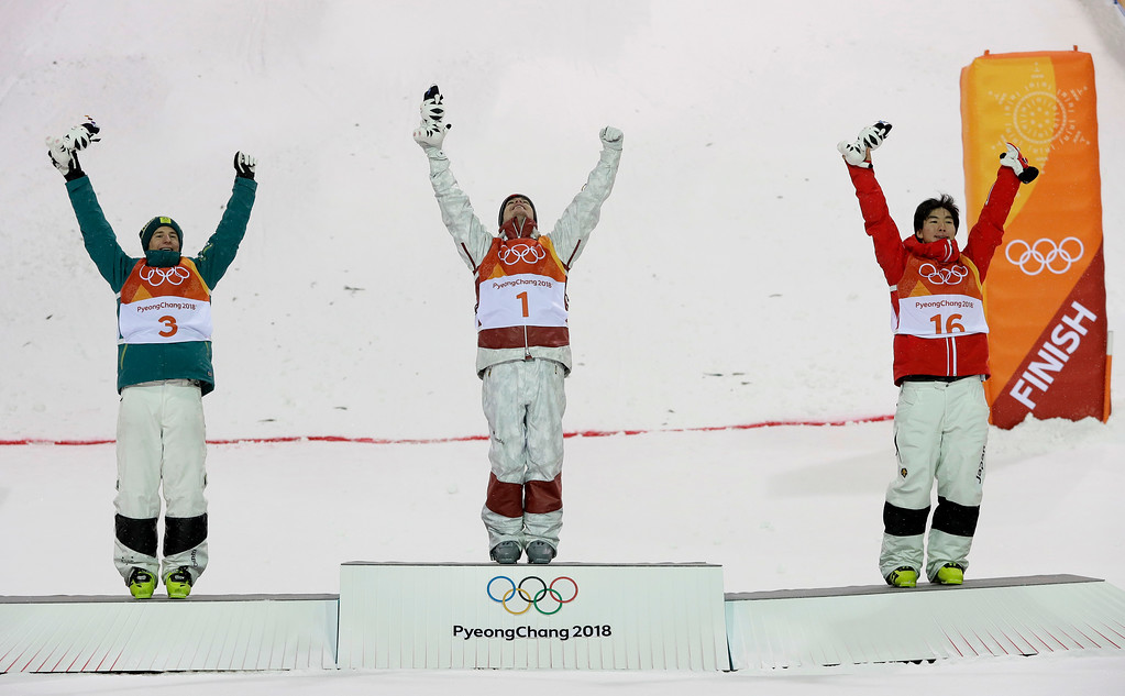 . From left; Silver medal winner Matt Graham, of Australia, gold medal winner Mikael Kingsbury, of Canada, and bronze medal winner Daichi Hara, of Japan, celebrate after the men\'s moguls qualifying at Phoenix Snow Park at the 2018 Winter Olympics in Pyeongchang, South Korea, Monday, Feb. 12, 2018. (AP Photo/Kin Cheung)