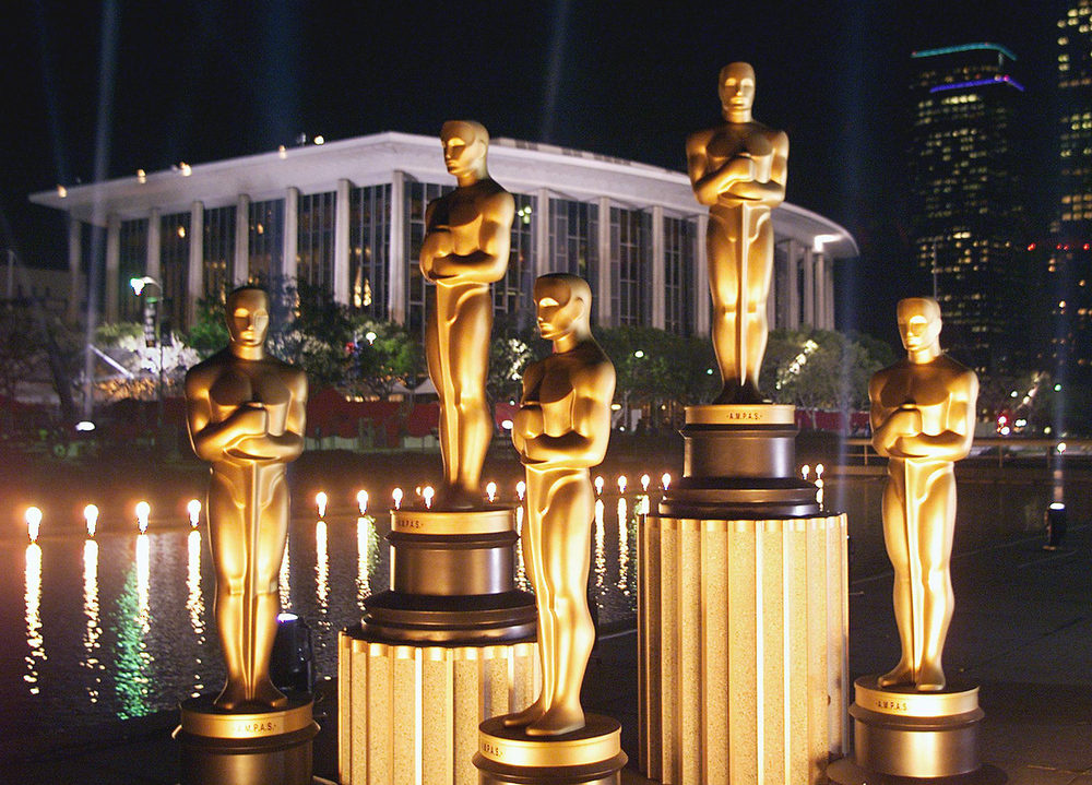 . Replicas of Oscar statues are lit in the night outside the Dorothy Chandler Pavilion 19 March 1999 in  Los Angeles ahead of the 71st Academy Awards to be held 21 March 1999 at the Pavilion.  TIMOTHY A. CLARY/AFP/Getty Images
