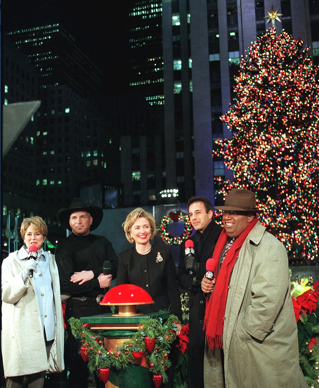 . First lady Hillary Rodham Clinton, center, and country and western singer Garth Brooks, join the NBC broadcast team of Jane Pauley, left, Al Roker, right, and Matt Lauer at the 66th annual lighting of the Rockefeller Center tree, Wednesday, Dec. 2, 1998, at New York\'s Rockefeller Center. (AP Photo/Ron Frehm)