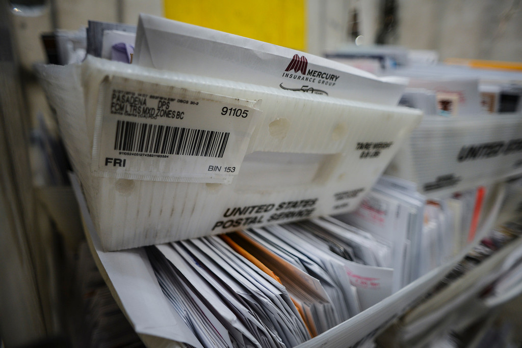 . Mail is stacked by zip code for sorting at the USPS Santa Clarita Processing & Distribution Plant.    Photo by David Crane/Los Angeles Daily News