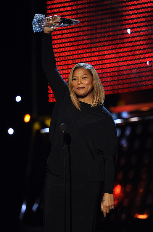 . LOS ANGELES, CA - JANUARY 08:  TV personality Queen Latifah accepts the Favorite New Talk Show Host award onstage at The 40th Annual People\'s Choice Awards at Nokia Theatre L.A. Live on January 8, 2014 in Los Angeles, California.  (Photo by Kevin Winter/Getty Images)
