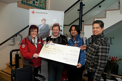 David Mulgrew (pictured 2nd right) organised a concert in association with the Red Cross to help the Phillipines Disaster and raised £3330. Pictured with david are Lorraine Holmes from the Red Cross along with Richard Decasto and Recto Abela representing the local Filipino community. R1410003