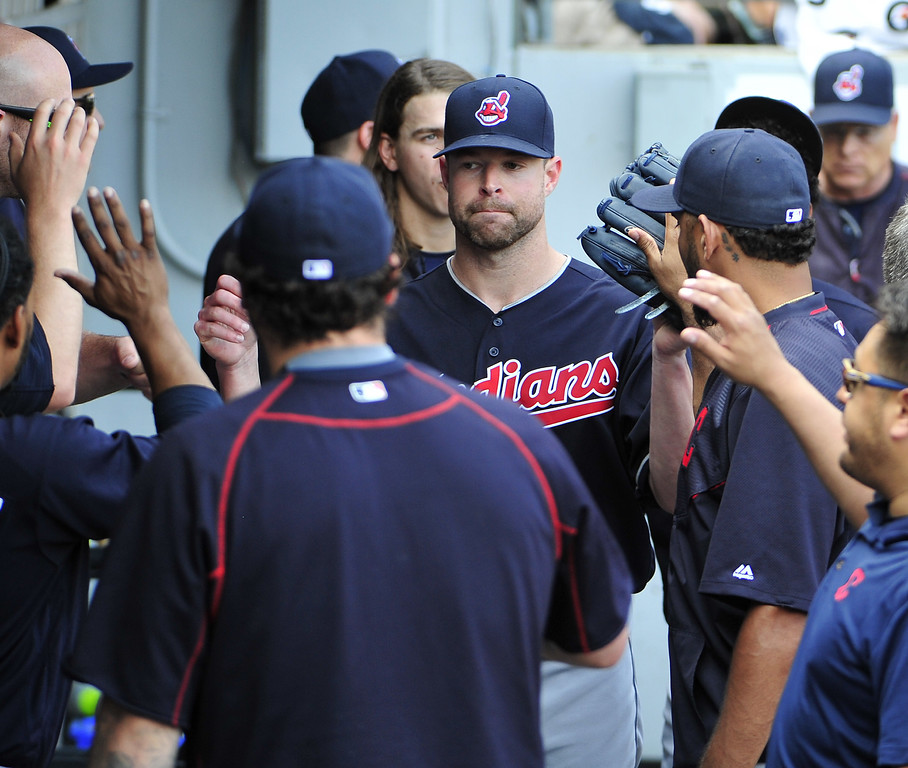 . Cleveland Indians starting pitcher Corey Kluber, center, is greeted by his teammates after being taken out during the eighth inning of a baseball game against the Chicago White Sox, Wednesday, May 25, 2016, in Chicago. (AP Photo/David Banks)