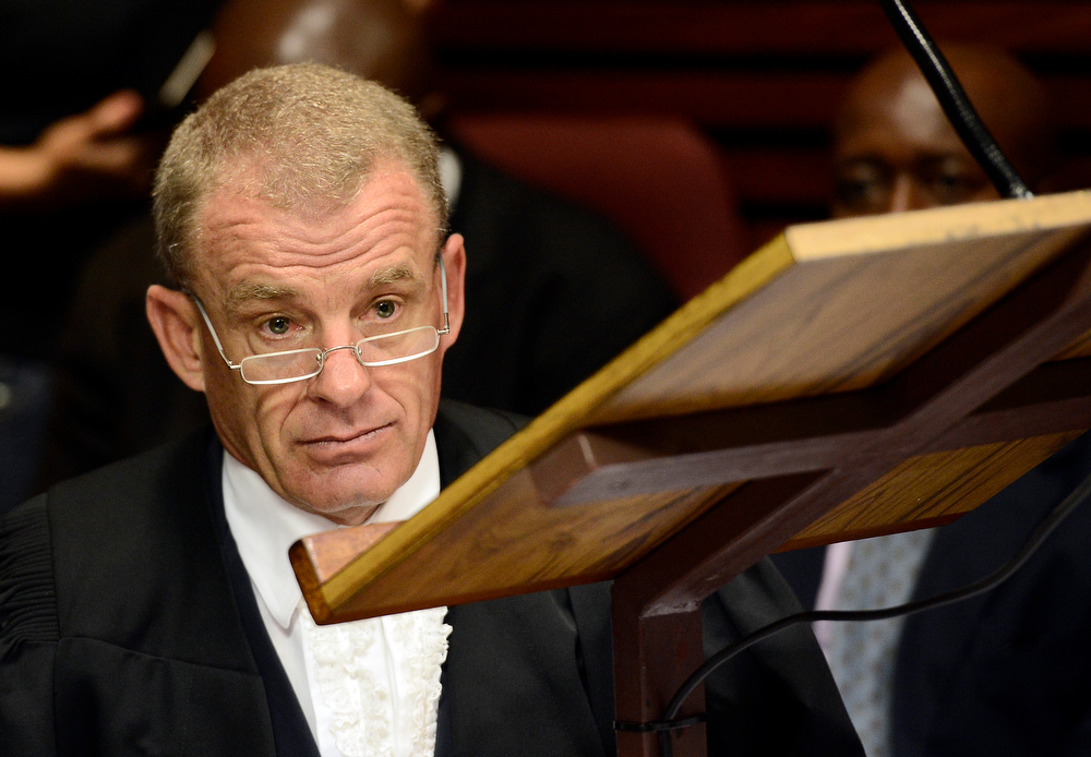Description of . South African Prosecutor Gerrie Nel attends on February 19, 2013 the bail hearing of South African Olympic sprinter Oscar Pistorius at the Magistrate Court in Pretoria. The hearing was postponed to February 20 to allow the prosecution time to study affidavits submitted by the defense. Pistorius is battling to secure bail as he appeared on charges of murdering his model girlfriend Reeva Steenkamp on February 14, Valentine's Day. South African prosecutors argued that Pistorius was guilty of premeditated murder in Steenkamp's death, a charge which could carry a life sentence.  STEPHANE DE SAKUTIN/AFP/Getty Images