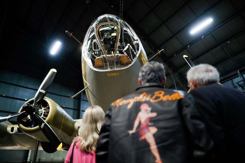". Visitors gather for a private viewing of the Memphis Belle, a Boeing B-17 ""Flying Fortress,\"" at the National Museum of the U.S. Air Force, Wednesday, May 16, 2018, in Dayton, Ohio. The World War II bomber Memphis Belle is set to go on display for the first time since getting a yearslong restoration at the museum. The B-17 �Flying Fortress� will be introduced Thursday morning as the anchor of an extensive exhibit in the Dayton-area museum�s World War II gallery. (AP Photo/John Minchillo)"
