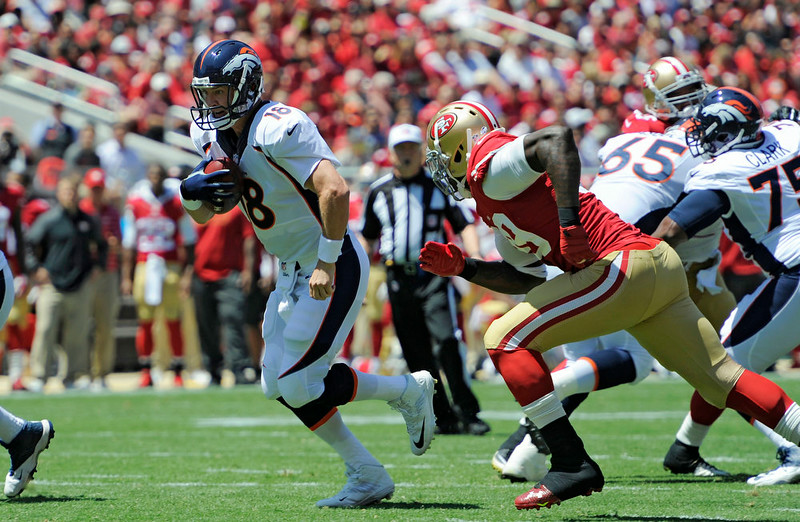 . Denver Broncos quarterback Peyton Manning (18) tucks the ball away and scrambles out of the pocket as he gets chased by  San Francisco 49ers outside linebacker Aldon Smith (99) during the first quarter August 17, 2014 at Levi\'s Stadium. (Photo by John Leyba/The Denver Post)