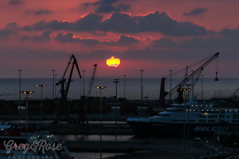 Sun Setting and Moon Rising at Heraklion