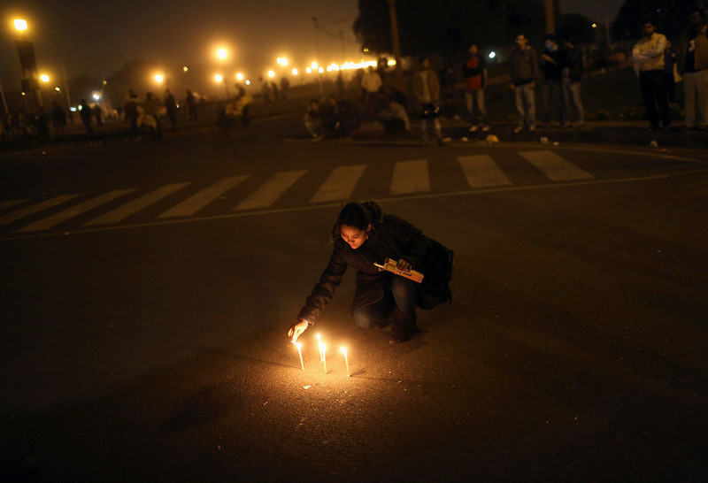 . A demonstrator lights candles near the presidential palace during a protest rally in New Delhi December 22, 2012. Indian police used batons, tear gas and water cannon to turn back thousands of people marching on the presidential palace on Saturday in intensifying protests against the gang-rape of a woman on the streets and on social media. REUTERS/Adnan Abidi