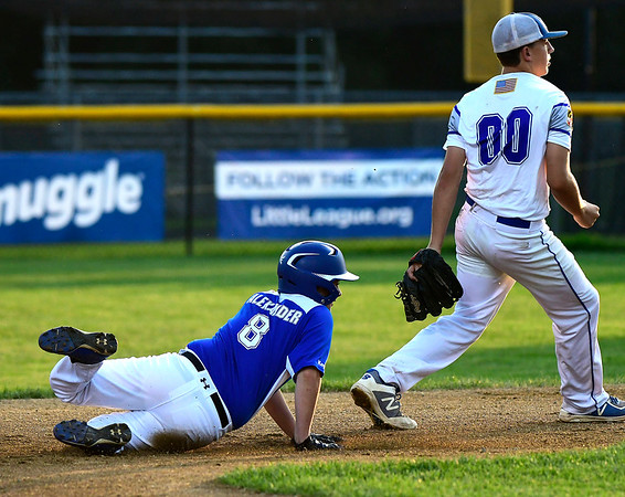 8/9/2018 Mike Orazzi | Staff Keystone Little League's Dallas Alexander (8) forced out at second by Maryland's Owen Knerr (00) at Breen Field in Bristol during Thursday evenings 2018 Eastern Regional Little League Baseball Tournament.