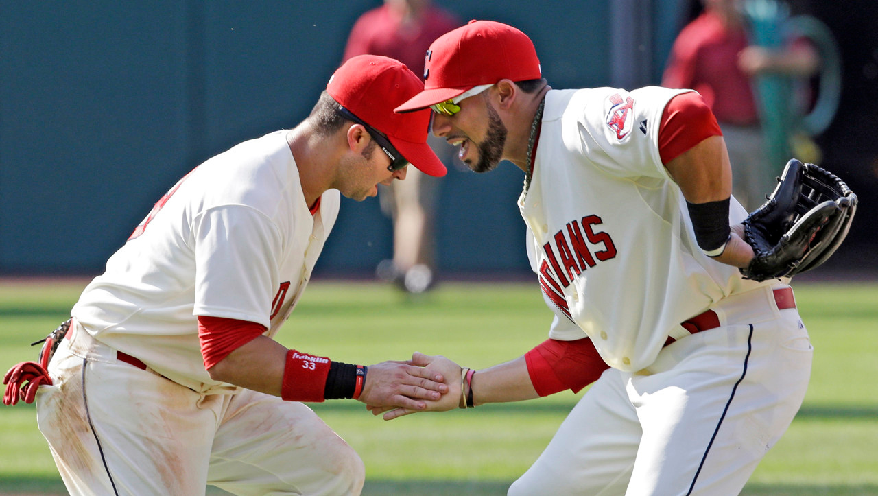 . Indians infielders Nick Swisher, left, and Mike Aviles celebrate after a 3-1 win over the Minnesota Twins at Progressive Field in Cleveland on Sunday August 25, 2013.  (AP Photo/Mark Duncan)