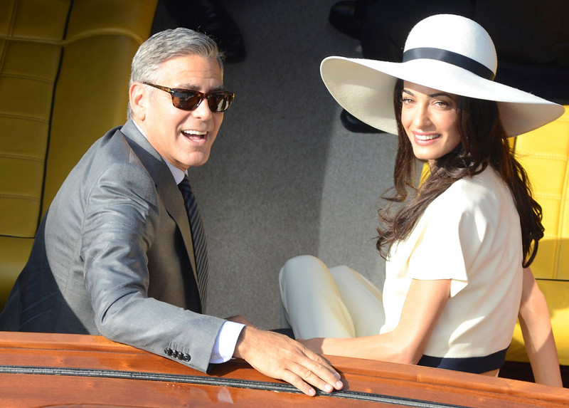 . George Clooney and his wife Amal Alamuddin leave the city hall after their civil marriage ceremony in Venice, Italy, Monday, Sept. 29, 2014. George Clooney married human rights lawyer Amal Alamuddin Saturday, the actor\'s representative said, out of sight of pursuing paparazzi and adoring crowds. (AP Photo/Luigi Costantini)