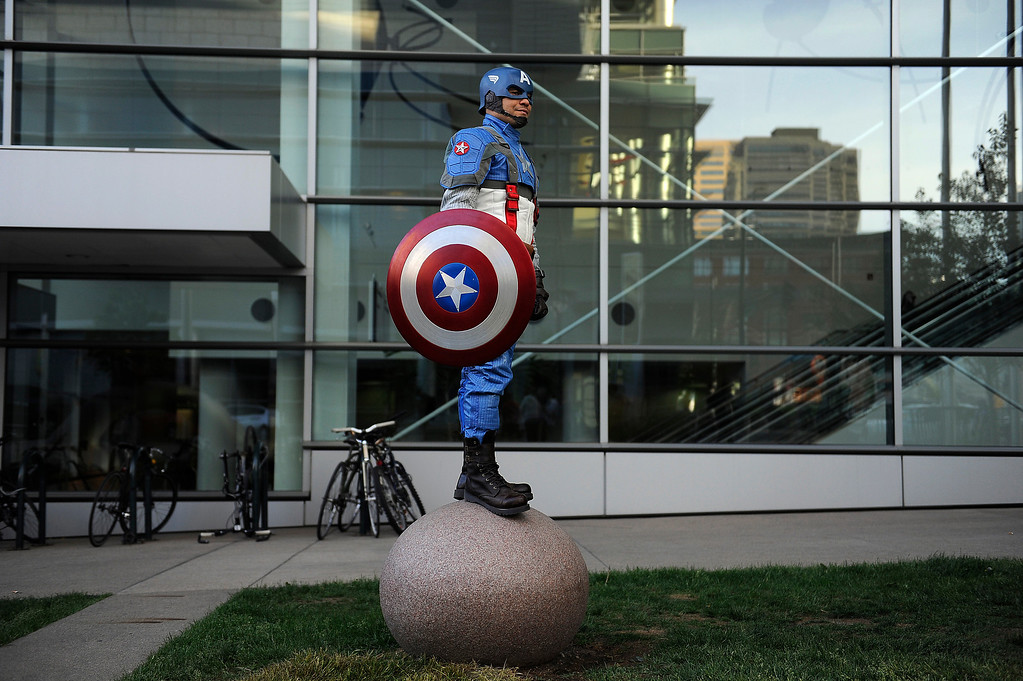 . DENVER, CO - MAY 31: Wilbert Rivera stands on a granite ball while taking a break outside of the Colorado Convention Center during Denver Comic Con at on May 31, 2013 in Denver, Colorado. (Photo by Seth McConnell/The Denver Post)
