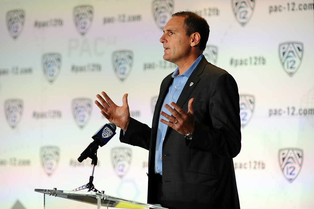 . Pac-12 Commissioner Larry Scott speaks during the PAC-12 Football Media Day at the Paramount Theater in Los Angeles, Ca July 23, 2014.(Andy Holzman/Los Angeles Daily News)