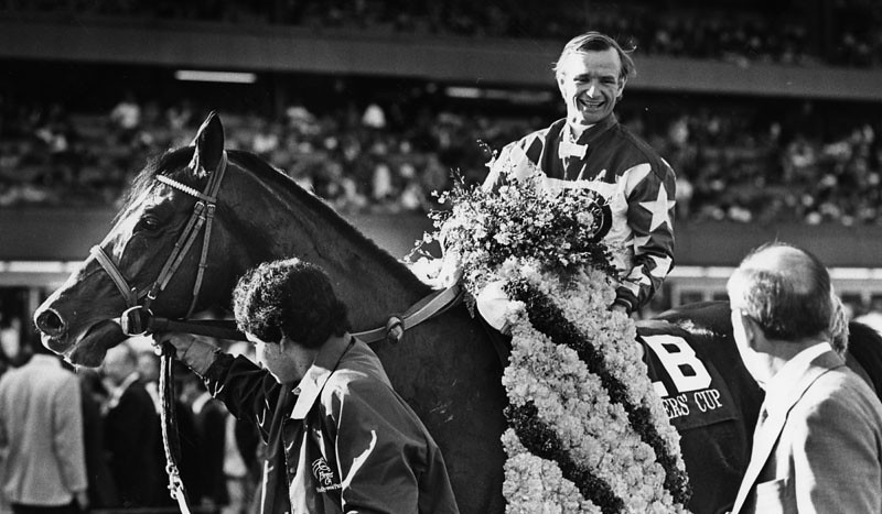 . Pat Day sits atop Turf winner Theatrical, his second victory of the afternoon at Hollywood Park in Inglewood. Photograph dated November 22, 1987.  (Los Angeles Public Library)
