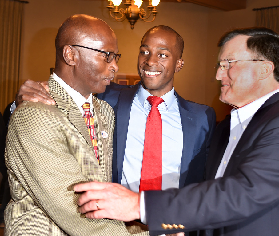 . Tyrone Hampton Senior with his son Tyron Hampton greeting Richard McDonald at Pasadena City Hall on election night. Hampton had a lead in votes over Calvin Wells for City Council District 1 Tuesday, April 21, 2015. (Photo by Walt Mancini/Pasadena Star-News)