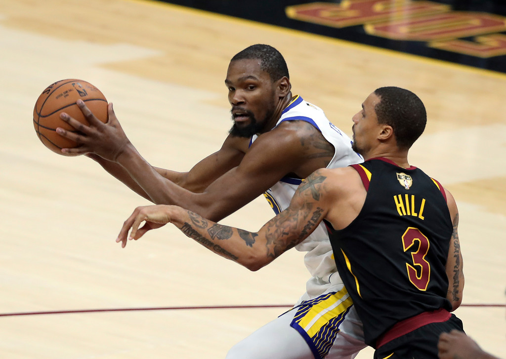 . Golden State Warriors\' Kevin Durant is defended by Cleveland Cavaliers\' George Hill during the second half of Game 3 of basketball\'s NBA Finals, Wednesday, June 6, 2018, in Cleveland. (AP Photo/Carlos Osorio)