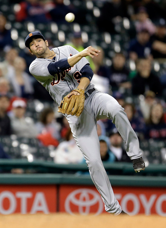 . Detroit Tigers\' Nick Castellanos throws to first base but not in time to get Cleveland Indians\' Yan Gomes in the seventh inning of a baseball game, Monday, May 19, 2014, in Cleveland. (AP Photo/Tony Dejak)