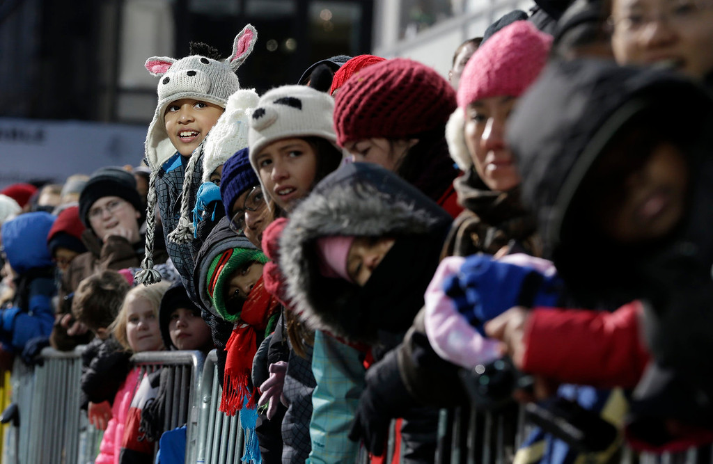 . Alan Nava, 9, top left, of Queens, N.Y., reacts as the Teenage Mutant Ninja Turtles float approach during the Macy\'s Thanksgiving Day Parade, Thursday, Nov. 28, 2013, in New York. (AP Photo/Julio Cortez)