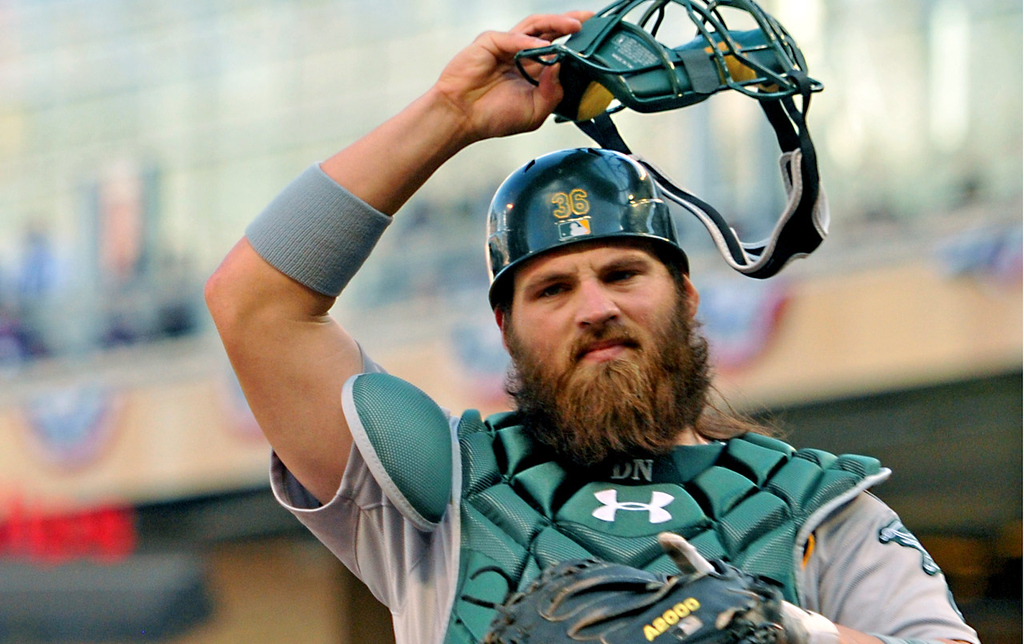 . Irritated Oakland catcher Derek Norris gets ready for the next Twins batter after Suzuki scored in the second inning. (Pioneer Press: John Autey)