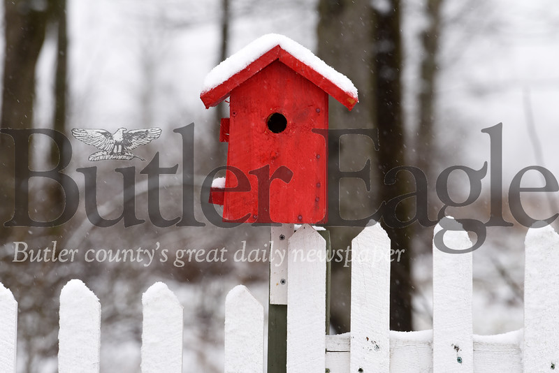 Harold Aughton/Butler Eagle: weather photo: Harold Aughton/Butler Eagle: Korean-war veteran, 90-year-old Delton Neal of Prospect (?) utilizes his woodshop to make customized furniture and birdfeeders.  He has 30 birdfeeders displayed on his white picket fence in his backyard.