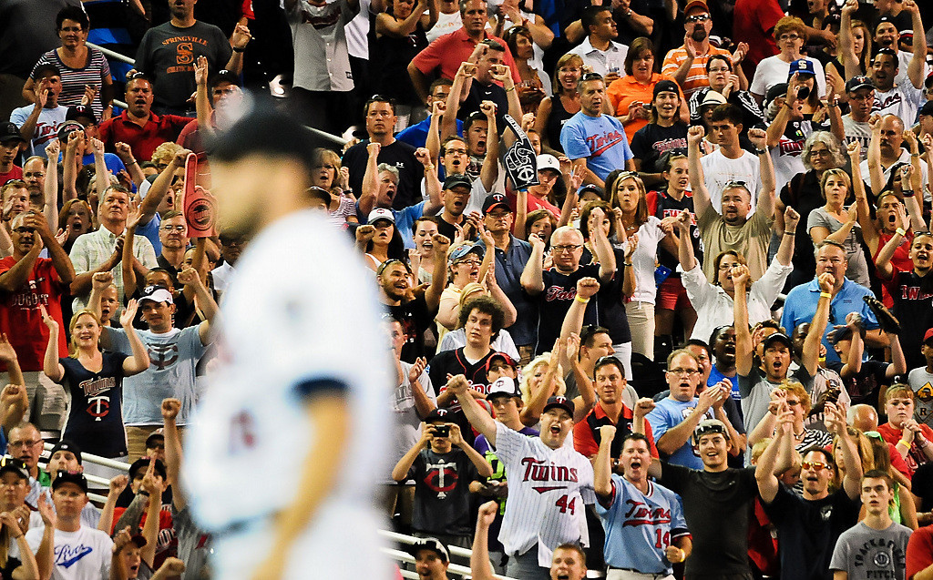 . Fans react after Minnesota Twins relief pitcher Glen Perkins threw the final pitch of the game as the Twins Beat the Indians at Target Field in Minneapolis, Minn., on Friday, July 19, 2013.  Twins won 3-2. (Pioneer Press: Ben Garvin)