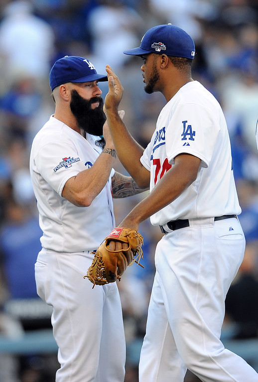. Dodgers Brian Wilson and Kenley Jansen high five after beating the Cardinals\' during game 5 of the NLCS at Dodger Stadium Wednesday, October 16, 2013. The Dodgers beat the Cardinals 6-4. (Photo by Hans Gutknecht/Los Angeles Daily News)
