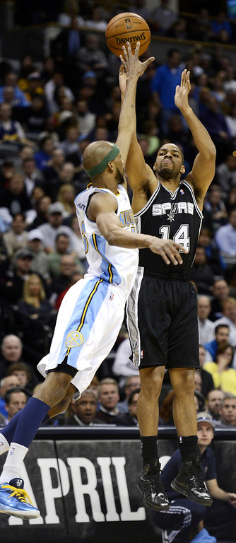 . San Antonio Spurs Gary Neal (14) takes a shot over Denver Nuggets Corey Brewer (13) during the first quarter April 10, 2013 at Pepsi Center. (Photo By John Leyba/The Denver Post)