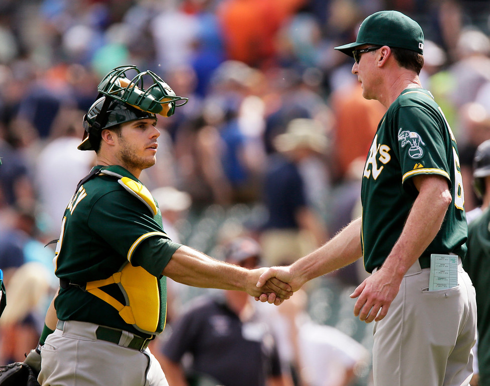 . Oakland Athletics catcher Josh Phegley shands hands with manager Bob Melvin after the Athletics\' 7-5 win over the Detroit Tigers in a baseball game Thursday, June 4, 2015, in Detroit. Phegley hit a two-run triple in the second inning. (AP Photo/Duane Burleson)