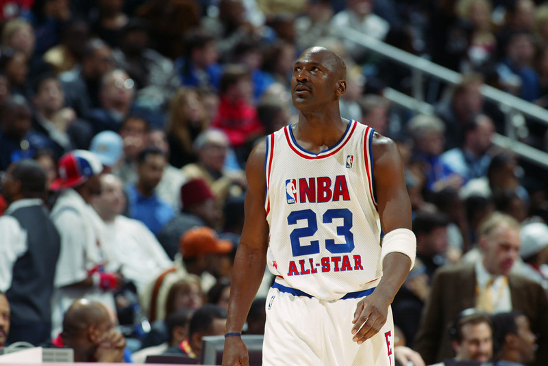 . ATLANTA - FEBRUARY 9:  Michael Jordan (Washington Wizards) #23 of the Eastern Conference All-Stars looks on at the 2003 NBA All-Star Game on February 9, 2003 at Philips Arena in Atlanta, Georgia.  (Photo by Jamie Squire/Getty Images)