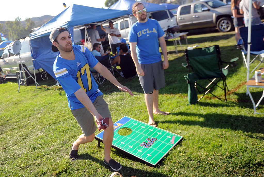 . UCLA fans Bo Weidner, left, with Justin Stiner play a toss the bean bag game prior to a college football game between Nevada and UCLA in the Rose Bowl on Saturday, Aug. 31, 2013 in Pasadena, Calif.    (Keith Birmingham Pasadena Star-News)