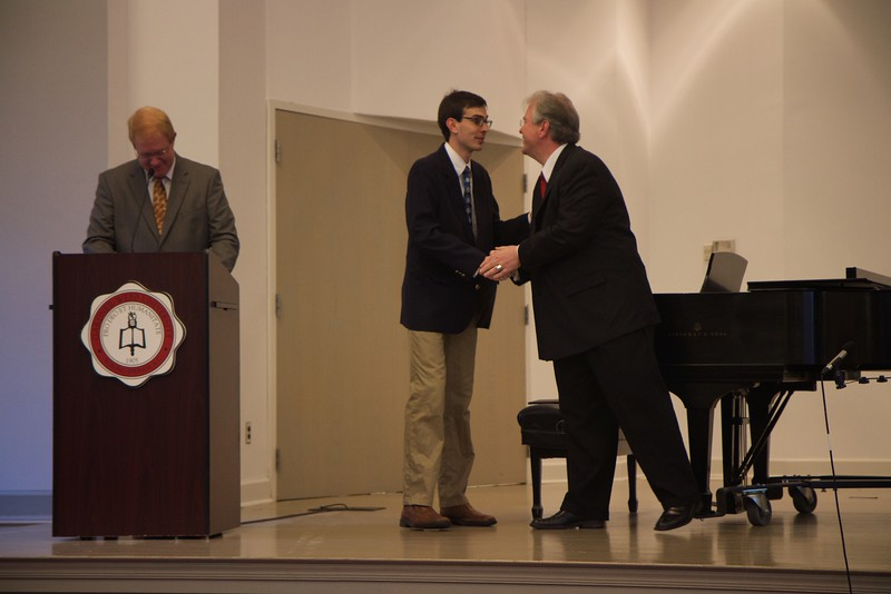 Passing of the Pi Kappa Lambda charter to initiate the Gardner-Webb Chapter of the national honors society for music, and induction ceremony. Adam White