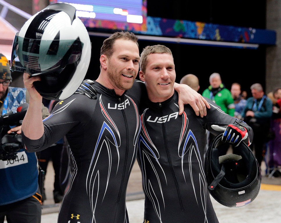 . The team from the United States USA-2, piloted by Cory Butner, left, and brakeman Christopher Fogt, wave to fans after their final run during the men\'s two-man bobsled competition at the 2014 Winter Olympics, Monday, Feb. 17, 2014, in Krasnaya Polyana, Russia. (AP Photo/Jae C. Hong)