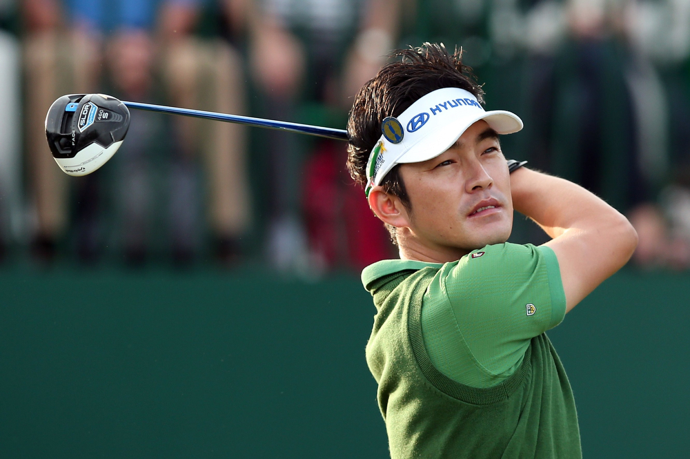 """. South Korea\'s Kim Hyung-Sung watches his drive from the 1st tee during his first round on the opening day of the 2014 British Open Golf Championship at Royal Liverpool Golf Course in Hoylake, north west England on July 17, 2014. England\'s former Ryder Cup star David Howell got the 143rd British Open underway just after the crack of dawn at Royal Liverpool Golf Club on Thursday with all eyes early on riveted on a \""""fit again\"""" Tiger Woods. (ANDREW YATES/AFP/Getty Images)"""