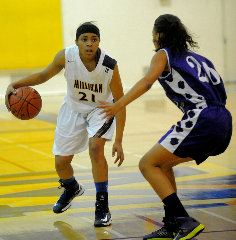 . 02-16-2012--(LANG Staff Photo by Sean Hiller)- Millikan vs. Rancho Cucamonga in Saturday night\'s  first-round CIF girls basketball game at Millikan High School in Long Beach. Erin Hagan looks to pass for Millikan against Rancho\'s Alexis Alexander.