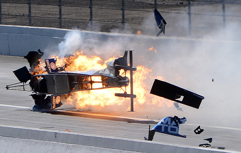 . Top Fuel driver Antron Brown\'s dragster suffers a major engine explosion blowing out both his rear tires while racing at over 300mph and crashing violently Sunday in Pomona. Brown was uninjured in the fiery crash February 17, 2013 at the 53rd annual NHRA Winternationals in Pomona. (Staff photo by Will Lester)