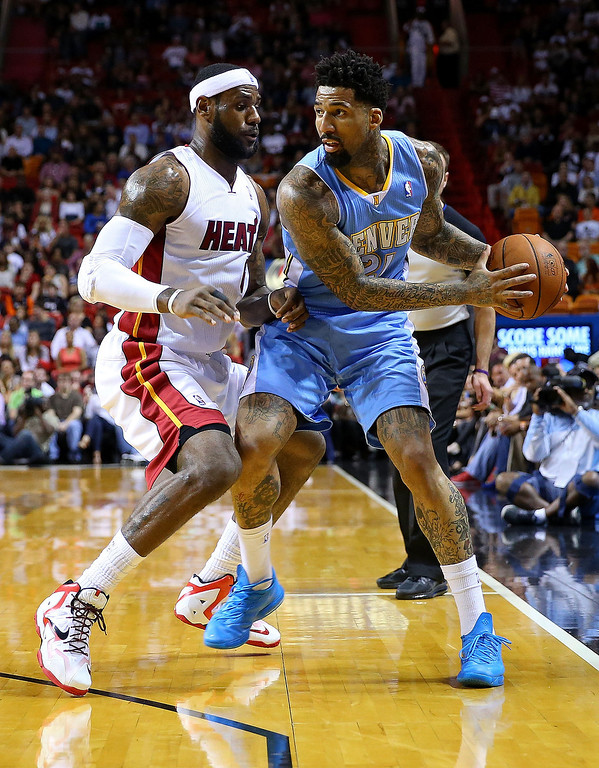 . MIAMI, FL - MARCH 14: Wilson Chandler #21 of the Denver Nuggets is defended by LeBron James #6 of the Miami Heat during a game  at American Airlines Arena on March 14, 2014 in Miami, Florida. (Photo by Mike Ehrmann/Getty Images)