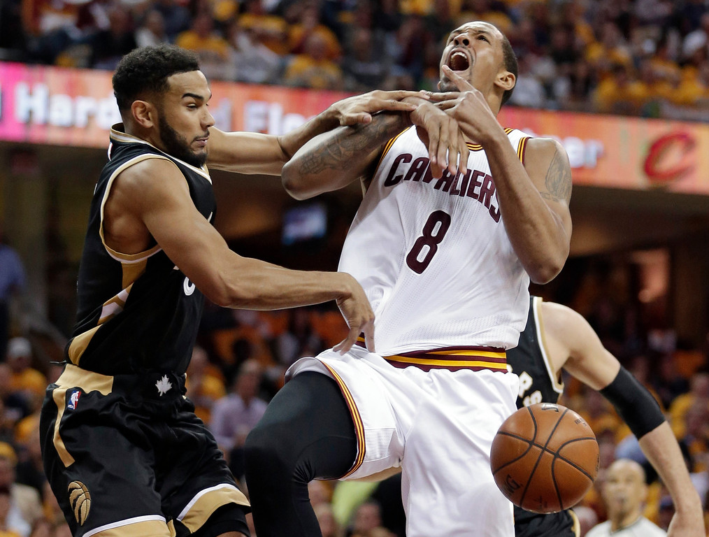 . Toronto Raptors\' Cory Joseph, left, knocks the ball loose from Cleveland Cavaliers\' Channing Frye during the first half of Game 2 of a second-round NBA basketball playoff series, Wednesday, May 3, 2017, in Cleveland. (AP Photo/Tony Dejak)
