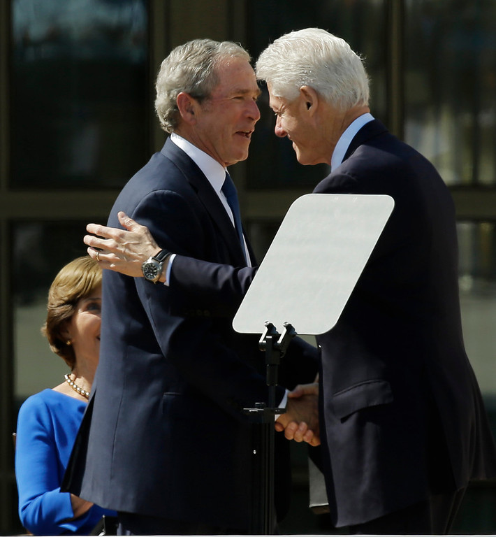 . Former president George W. Bush, left, shakes hands with former president William J. Clinton during the dedication of the George W. Bush Presidential Center Thursday, April 25, 2013, in Dallas. (AP Photo/David J. Phillip)