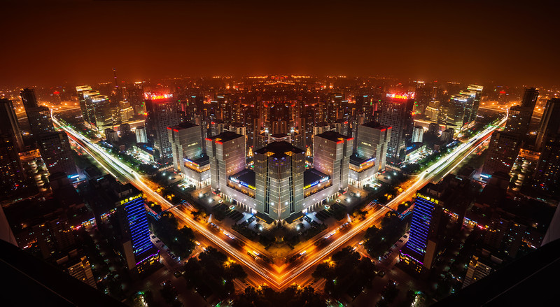 The Sprawling City I'm experimenting with this style of city photography. I like this idea of reflection that is imperfect. I shot this from the top of one of the only television stations in Beijing. It was a perfect night without any wind. There was a lot of pollution, so the warm city lights cast a red glow into the ether…- Trey RatcliffClick here to read the rest of this post at the Stuck in Customs blog.