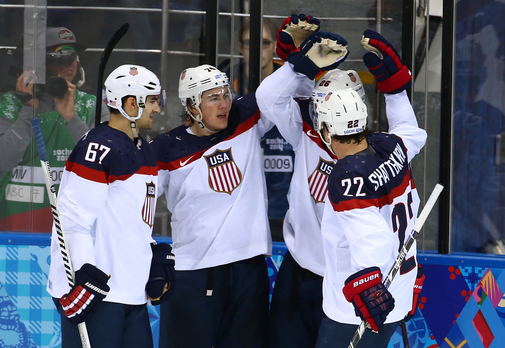 . Paul Stastny #26 of United States celebrates with team-mates after scoring a goal against Jaroslav Halak #41 of Slovakia in the second period during the Men\'s Ice Hockey Preliminary Round Group A game on day six of the Sochi 2014 Winter Olympics at Shayba Arena on February 13, 2014 in Sochi, Russia.  (Photo by Streeter Lecka/Getty Images)